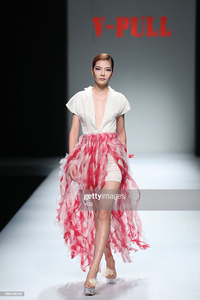 A model showcases designs by He Wei on the runway at the V-PULL Jeans Collection show during Mercedes-Benz China Fashion Week Spring/Summer 2014 at Beijing Hotel on October 31, 2013 in Beijing, China.