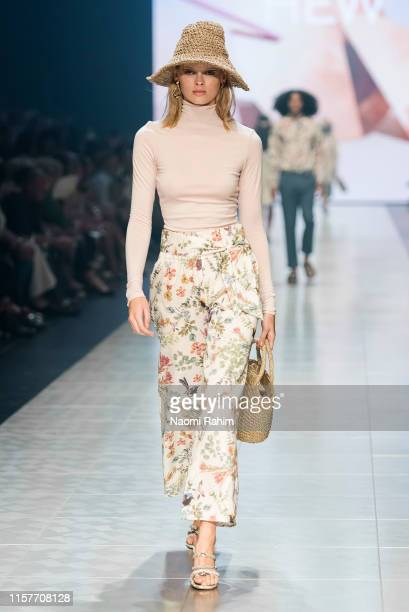 A model showcases designs by HEW during Runway 6 at Melbourne Fashion Festival on March 9 2019 in Melbourne Australia