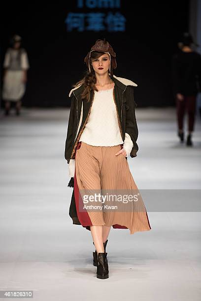 Model showcases designs by Ho Wai Yee, Tomi on the runway during the Hong Kong Young Fashion DesignersÍ Contest 2015 on day 2 of Hong Kong Fashion...