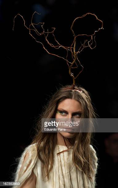 A model showcases designs by HOWL by Maria Glüik on the runway at the HOWL show during Mercedes Benz Fashion Week Madrid Fall/Winter 2013/14 at Ifema...