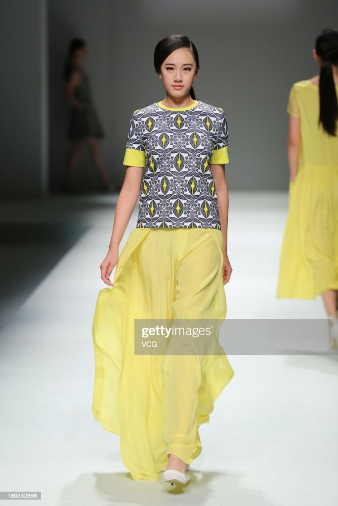 A model showcases designs by Huang Liyong on the runway at the HLYHLU Huang Liyong Collection show during Mercedes-Benz China Fashion Week Spring/Summer 2014 at Beijing Hotel on October 30, 2013 in Beijing, China.