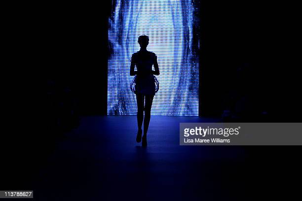 A model showcases designs by Illuminati during the Raffles catwalk during Rosemount Australian Fashion Week Spring/Summer 2011/12 at Overseas...