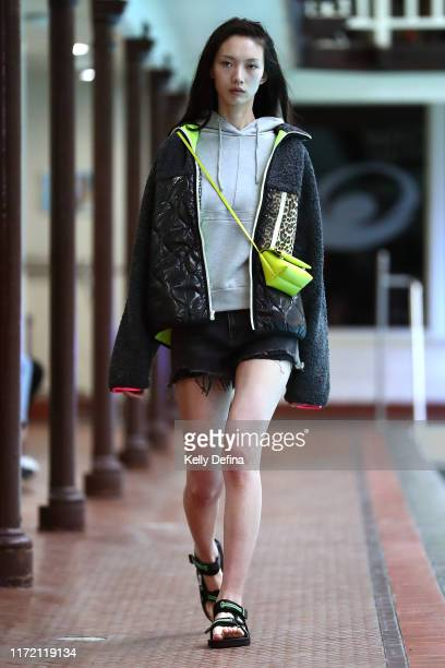 A model showcases designs by Incu during the Poolside Runway at Melbourne Fashion Week at Melbourne City Baths on September 04 2019 in Melbourne...