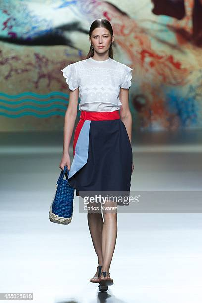 Model showcases designs by Ion Fiz on the runway at Ion Fiz show during Mercedes Benz Fashion Week Madrid Spring/Summer 2015 at Ifema on September...
