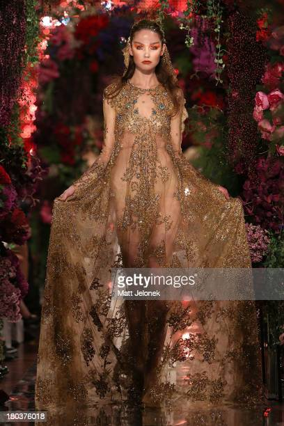 Model showcases designs by Jaime Lee on the runway during Perth Fashion Festival at The Western Australian Museum on September 12, 2013 in Perth,...