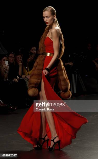 A model showcases designs by Jesus Lorenzo on the runway at Jesus Lorenzo show during Mercedes Benz Fashion Week Madrid Fall/Winter 2014 at Ifema on...