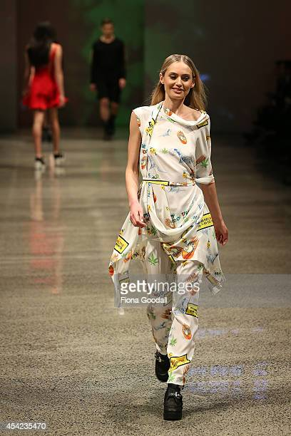 A model showcases designs by Jimmy D in the Resene Designer Selection Show at New Zealand Fashion Week 2014 on August 27 2014 in Auckland New Zealand
