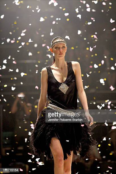 A model showcases designs by Johanna Johnson on the catwalk as part of the MercedesBenz Fashion Festival Sydney 2012 at Sydney Town Hall on August 25...