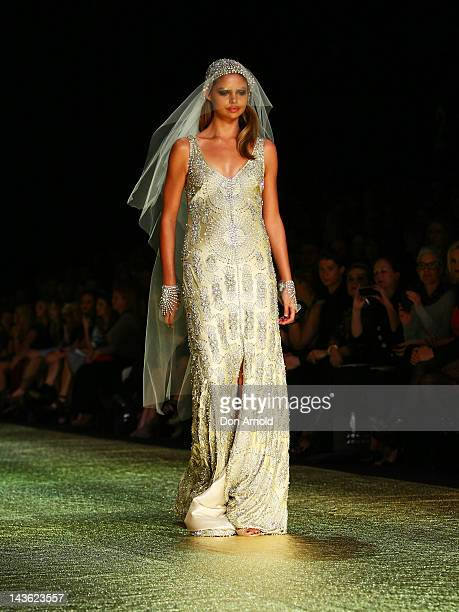 Model showcases designs by Johanna Johnson on the catwalk on day two of Mercedes-Benz Fashion Week Australia Spring/Summer 2012/13 at Overseas...