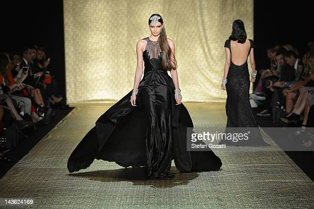A model showcases designs by Johanna Johnson on the catwalk on day two of MercedesBenz Fashion Week Australia Spring/Summer 2012/13 at Overseas...