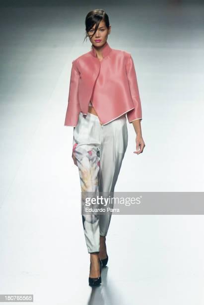 Model showcases designs by Juan Vidal on the runway at Juan Vidal show during Mercedes Benz Fashion Week Madrid Spring/Summer 2014 at Ifema on...