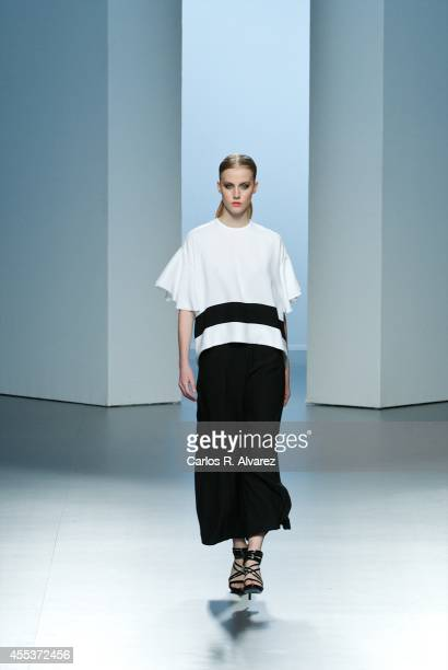 Model showcases designs by Juana Martin on the runway at Juana Martin show during Mercedes Benz Fashion Week Madrid Spring/Summer 2015 at Ifema on...