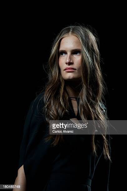 A model showcases designs by Juanjo Oliva on the runway at Juanjo Oliva show during Mercedes Benz Fashion Week Madrid Spring/Summer 2014 at Ifema on...