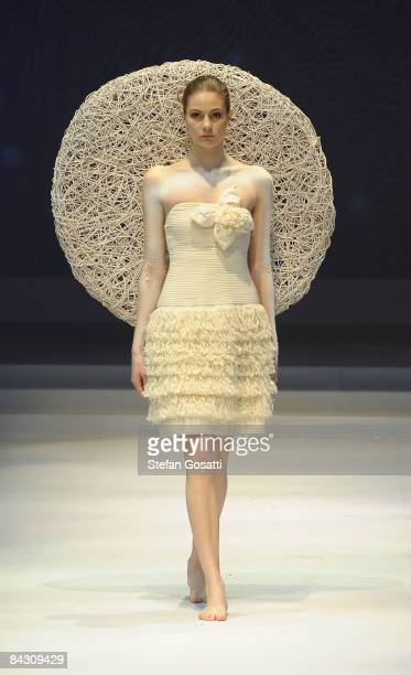 A model showcases designs by Kai Ping as part of the Fashion Shenzen show on the catwalk as part of Hong Kong Fashion Week Fall/Winter 2009 at the...