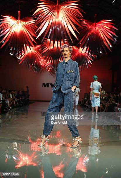 Model showcases designs by Karen Walker during the Myer Spring Summer 2014 Fashion Launch at Carriageworks on August 7, 2014 in Sydney, Australia.