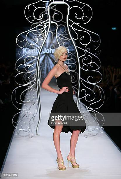 Model showcases designs by Kirrily Johnston during the Little Black Dress show on the catwalk at the Overseas Passenger Terminal, Circular Quay on...