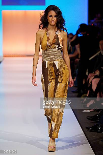 Model showcases designs by Kooey during the STM Swimwear collection catwalk show as part of Perth Fashion Week 2010 at Fashion Paramount on September...