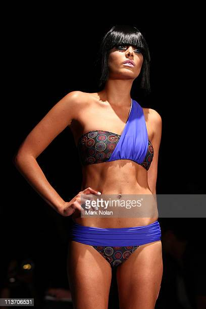 Model showcases designs by Kooey on the catwalk during Rosemount Australian Fashion Week Spring/Summer 2011/12 at Overseas Passenger Terminal on May...