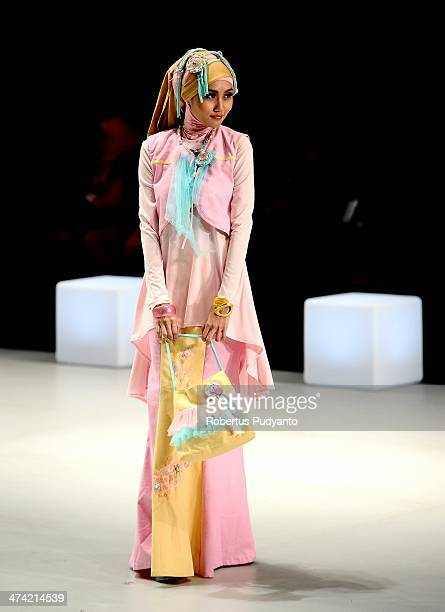 A model showcases designs by Korina Budiman on the runway at The My Lolly show during Indonesia Fashion Week 2014 day 3 at Jakarta Convention Center...