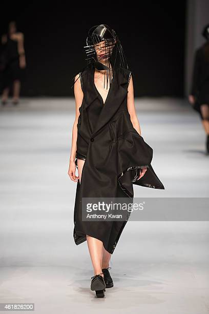 A model showcases designs by Kwan Mei Mui on the runway during the Hong Kong Young Fashion DesignersÕ Contest 2015 on day 2 of Hong Kong Fashion Week...