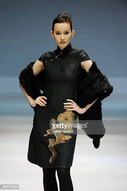 A model showcases designs by Laxx Couture as part of the International Fashion Designers Show 2 on the catwalk as part of Hong Kong Fashion Week...
