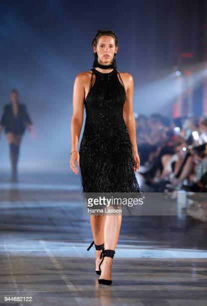 A model showcases designs by Leah Da Gloria during the Jurassic World Fallen Kingdom Runway Show on April 11 2018 in Sydney Australia
