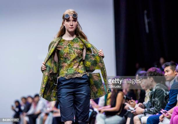 A model showcases designs by Lia Kassif on the runway during the Redress The EcoChic Design Award 2017 Grand Final Fashion Show on the Day 2 of the...