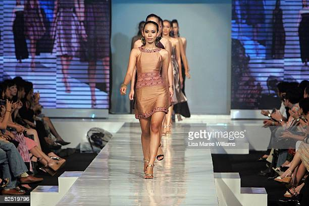 A model showcases designs by Liliana Lim of the IPMI at the Contemporary 3 show on the catwalk on the second day of the inaugural Festival Mode...