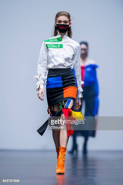 Model showcases designs by Lina Mayorga on the runway during the Redress: The EcoChic Design Award 2017: Grand Final Fashion Show on the Day 2 of the...