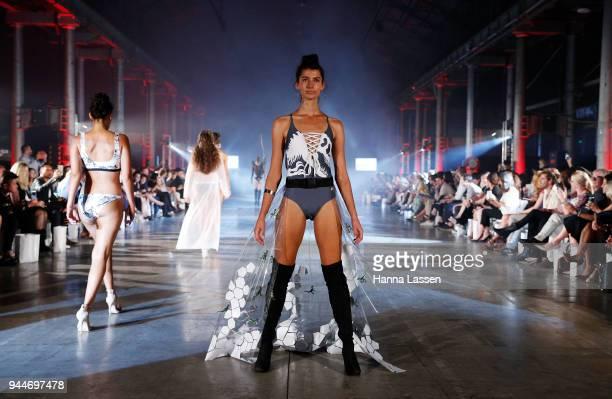 A model showcases designs by LunarSand during the Jurassic World Fallen Kingdom Runway Show on April 11 2018 in Sydney Australia