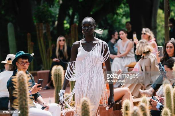 Model showcases designs by Maara Collective during the Arid Garden Runway as part of Melbourne Fashion Week on November 24, 2020 in Melbourne,...