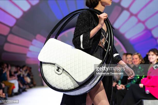 A model showcases designs by Madam Virtue Co and Chanel during Town Hall Runway 5 at Melbourne Town Hall at Melbourne City Baths on September 04 2019...
