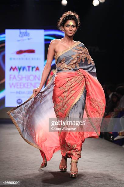A model showcases designs by Mandira Bedi during day 3 of Myntra Fashion Weekend 2014 at The Palladium Hotel on October 5 2014 in Mumbai India