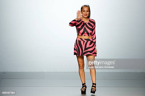 A model showcases designs by Maria Escote on the runway at the Maria Escote show during Mercedes Benz Fashion Week Madrid Spring/Summer 2015 on...