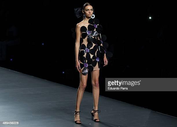 A model showcases designs by Maria Escote on the runway at the Maria Escote show during MercedesBenz Fashion Week Madrid Spring/Summer 2015/16 at...