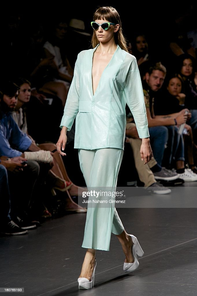 A model showcases designs by Martin Lamothe on the runway at Martin Lamothe show during Mercedes Benz Fashion Week Madrid Spring/Summer 2014 at Ifema on September 16, 2013 in Madrid, Spain.
