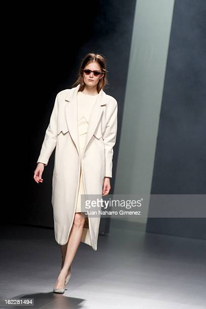 A model showcases designs by Martin Lamothe on the runway at the Martin Lamothe show during Mercedes Benz Fashion Week Madrid Fall/Winter 2013/14 at...