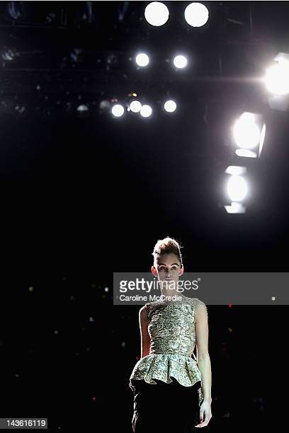 A model showcases designs by Maticevski on the catwalk on day two of MercedesBenz Fashion Week Australia Spring/Summer 2012/13 at Overseas Passenger...