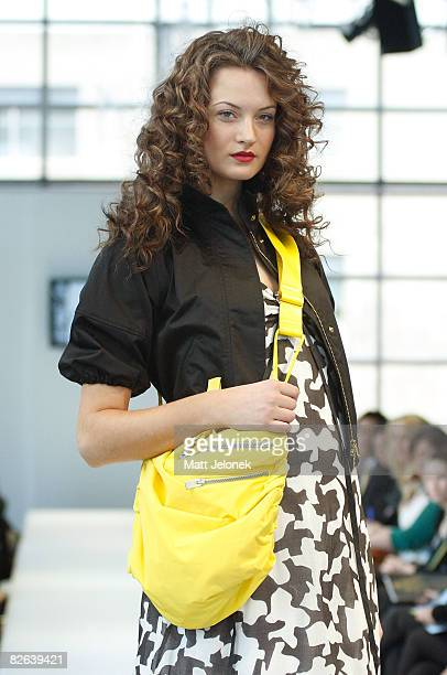 A model showcases designs by Max Co as part of the Melbourne's GPO Racing into Spring Fashion Parade catwalk show on the second day of Melbourne...