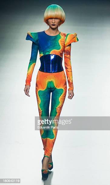 A model showcases designs by Maya Hansen on the runway at Maya Hansen show during Mercedes Benz Fashion Week Madrid Spring/Summer 2014 at Ifema on...