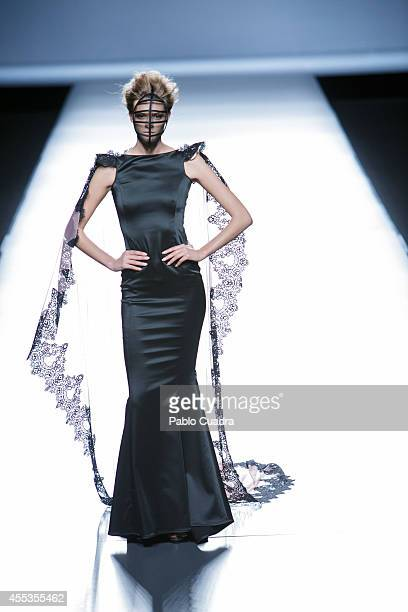 A model showcases designs by Maya Hansen on the runway during Mercedes Benz Fashion Week Madrid Spring/Summer 2015 at Ifema on September 13 2014 in...