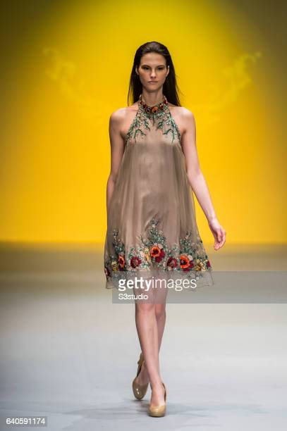 A model showcases designs by Meggie during the Day 3 of the Hong Kong Fashion Week for Fall / Winter 2015 at the Hong Kong Convention and Exhibition...