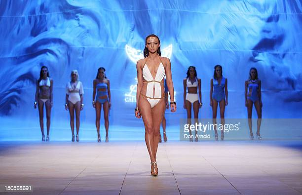 A model showcases designs by Miami Swim on the catwalk as part of the MercedesBenz Fashion Festival Sydney 2012 at Sydney Town Hall on August 22 2012...