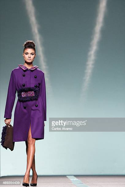 A model showcases designs by Miguel Palacio on the runway at Miguel Palacio show during Mercedes Benz Fashion Week Madrid Fall/Winter 2014 at Ifema...