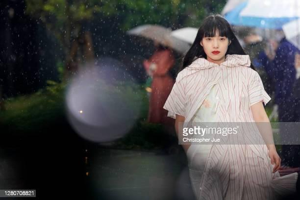 Model showcases designs by MIKIO SAKABE on the runway during Rakuten Fashion Week TOKYO 2021 spring/summer at Miyashita Park on October 17, 2020 in...