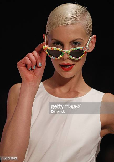 A model showcases designs by Miss Unkon on the catwalk as part of Mercedes Benz Fashion Festival Sydney 2012 at Sydney Town Hall on August 25 2012 in...