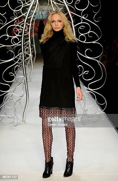 A model showcases designs by Missoni at the Diet CocaCola Little Black Dress Show on the catwalk at the Overseas Passenger Terminal Circular Quay on...