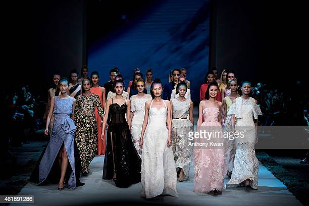 A model showcases designs by MOISELLE on the runway during the MOISELLE Spring/Summer 2015 Fashion Show on day 3 of Hong Kong Fashion Week...