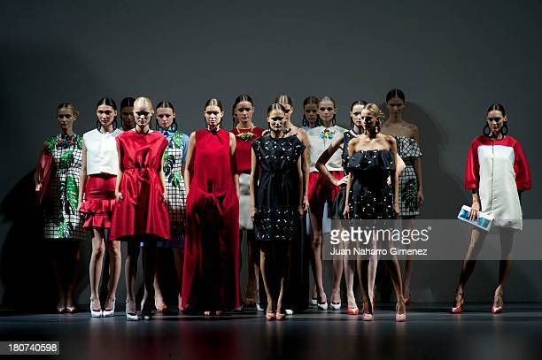 A model showcases designs by Moises Nieto on the runway at Moises Nieto show during Mercedes Benz Fashion Week Madrid Spring/Summer 2014 at Ifema on...