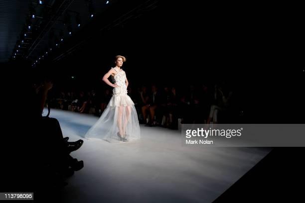 Model showcases designs by Mok Theorem during the New Generation 1 catwalk during Rosemount Australian Fashion Week Spring/Summer 2011/12 at Overseas...
